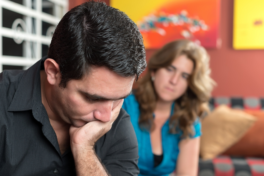 Divorce, marital problems- Sad and worried man with his wife loo